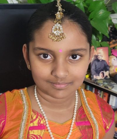 Wearing a traditional Indian dress is a fourth grader Jayani. The KumKum between her eyebrows is a powder used for social and religious markings in India. It is usually made of tumeric.