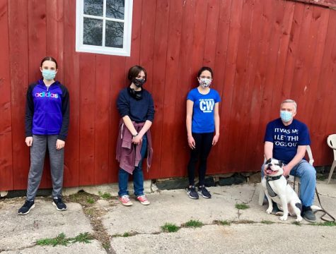 The volunteers (including Katelyn Grant and Alex Hannah) at the Friday event with Daniel DePew and Buddy.