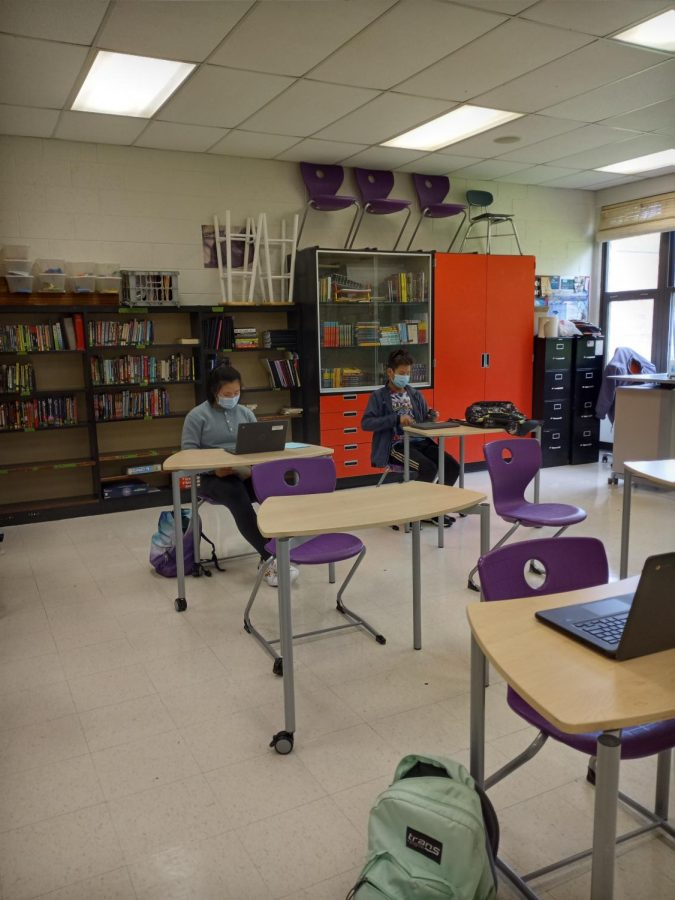 Seventh graders Jennifer Tang and Edward Zhang in Mr. Cartman's English room on Friday getting their chromebooks out to get ready for class to start.